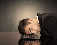 Frustrated businessman's head on keyboard Stock Photography