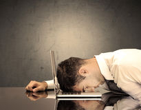 Frustrated businessman`s head on keyboard Stock Image
