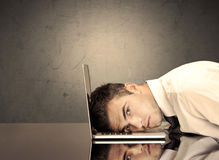Frustrated businessman`s head on keyboard Stock Photography