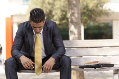 Frustrated businessman sit at the bench park Royalty Free Stock Photos