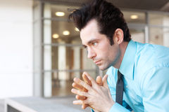 Frustrated businessman sitting on a bench Stock Images