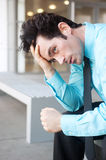 Frustrated businessman sitting on a bench Royalty Free Stock Images