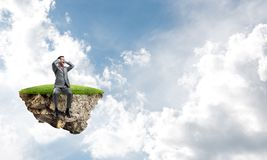 Young man on floating island do not want to hear anything Stock Photos