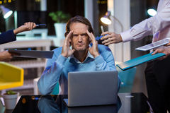 Frustrated businessman sitting in office Stock Photo
