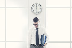 Frustrated businessman standing under a clock Stock Photography