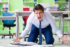 The frustrated businessman stressed from excessive work royalty free stock image