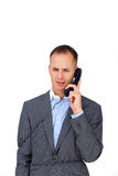 Frustrated businessman tangled up in phone wires Stock Photography