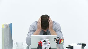 Frustrated businessman working in office