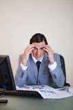 Frustrated businessman working on statistics Stock Image