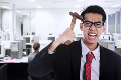 Frustrated businessman at workplace Royalty Free Stock Image