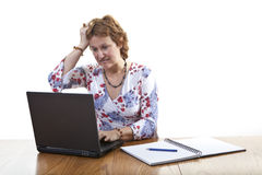 Frustrated businesswoman. Working on a laptop Royalty Free Stock Photo