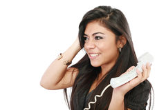 Frustrated businesswoman. Talking on phone against a white background Stock Images