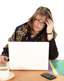 Frustrated Businesswoman. Frustrated middle aged businesswoman stares at her laptop screen Royalty Free Stock Image