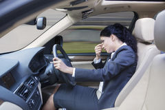Frustrated businesswoman driving car Stock Image