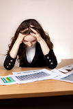 Frustrated businesswoman with financial report Royalty Free Stock Photo