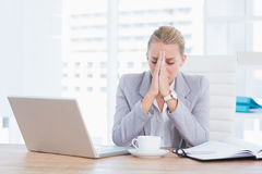 Frustrated businesswoman with head in hands Stock Image
