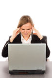 Frustrated businesswoman with headache sitting at office desk Royalty Free Stock Photos