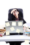 Frustrated businesswoman with her tasks Royalty Free Stock Photo