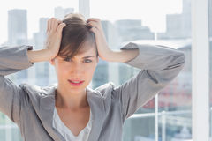 Frustrated businesswoman looking at camera Stock Photos