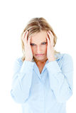 Frustrated businesswoman looking to the side. Frustrated caucasian businesswoman looking to the side against white background Royalty Free Stock Image