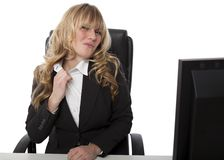Frustrated businesswoman loosening her collar Royalty Free Stock Image