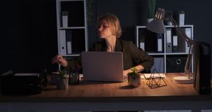 Businesswoman looking for a lost note at office desk. Frustrated businesswoman searching for a lost note at office desk stock video footage