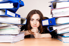 Frustrated businesswoman with stack of folders Stock Photos