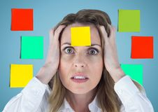 Frustrated businesswoman with sticky note stuck on her forehead Royalty Free Stock Photography