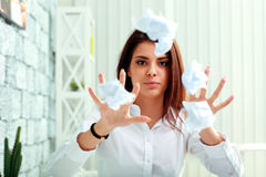 Frustrated businesswoman throwing paper Stock Image