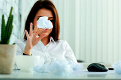 Frustrated businesswoman throwing paper Royalty Free Stock Image