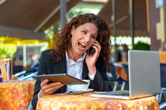 Frustrated businesswoman yelling into her mobile Stock Photos
