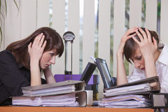 Frustrated businesswomen by work Royalty Free Stock Image