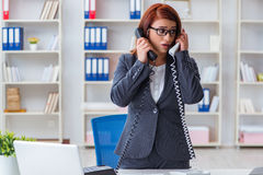 The frustrated call center assistant responding to calls Stock Images