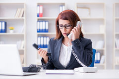 The frustrated call center assistant responding to calls Royalty Free Stock Images
