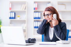 The frustrated call center assistant responding to calls Stock Photos