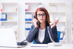 The frustrated call center assistant responding to calls Royalty Free Stock Photos