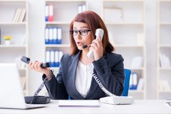 The frustrated call center assistant responding to calls Stock Image
