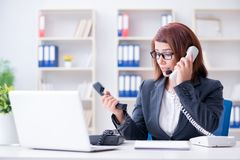 The frustrated call center assistant responding to calls. Frustrated call center assistant responding to calls Stock Photography