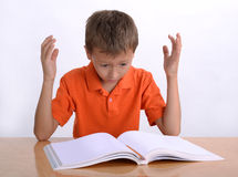 Frustrated child with learning difficulties. Frustrated, upset child, or child with learning difficulties royalty free stock photos