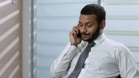 Frustrated clerk. Businessman talking on the phone. Unsuccessful phone conversation. Frustrated clerk stock footage