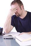 Frustrated College Student with Books on the Table Royalty Free Stock Photo