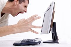 Frustrated on computer. A man screaming on computer...frustration stock photo