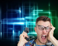 Frustrated computer engineer screaming while on call Stock Photos
