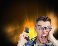 Frustrated computer engineer screaming while on call Royalty Free Stock Image