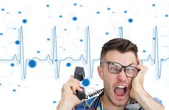 Frustrated computer engineer screaming while on call Stock Photography