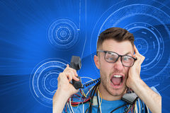 Frustrated computer engineer screaming while on call in front of open cpu Royalty Free Stock Photography