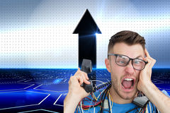 Frustrated computer engineer screaming while on call in front of open cpu Stock Image