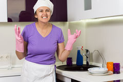 Frustrated cook wringing her hands in desperation Stock Photos