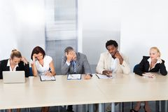 Frustrated corporate personnel officers at panel Royalty Free Stock Photos