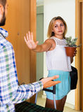 Frustrated couple standing at doorway Royalty Free Stock Images